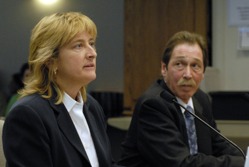 Gladys Gillis, CEO of Starline Luxury Coaches and Tom Casazza, operations manager at Starline and president of the Northwest Motorcoach Association, testify Thursday before the Senate Transportation Committee on SB 6570.