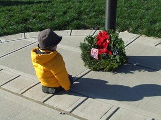 Boy with Christmas Wreath, Dec 2011